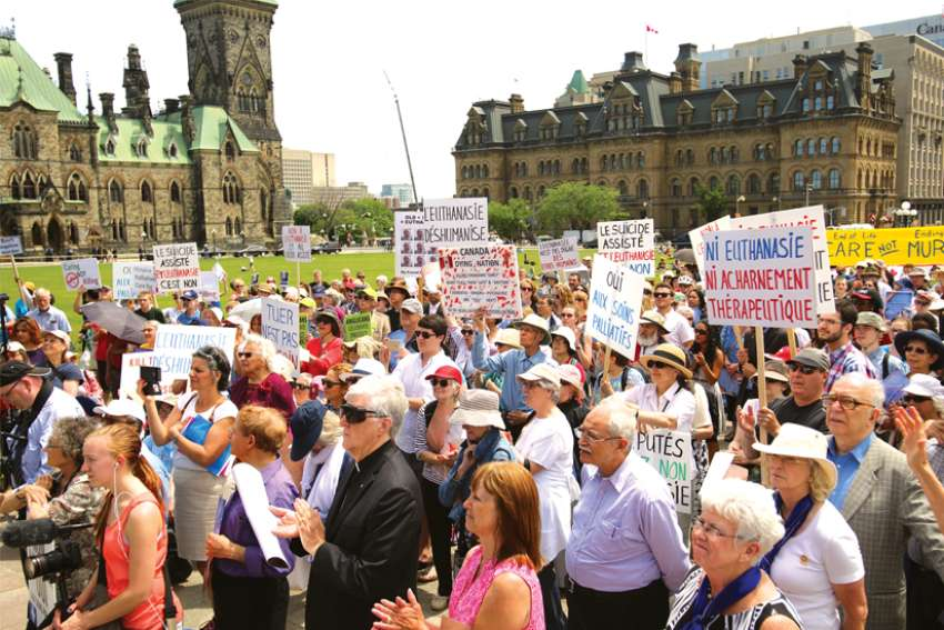 Opponents of euthanasia and assisted suicide rallied on Parliament Hill in June 2016 during the debate on the doctor-assisted dying bill, which became law. More changes are now being debated.