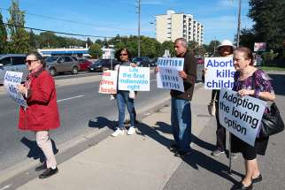 Men and women formed a Life Chain to protest abortion at Yonge and Steeles in Toronto. The annual event is held in more than 1,600 North American cities.