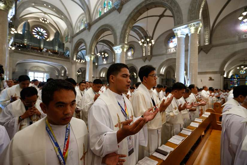 Clergy attend Pope Francis' Mass with bishops, priests and members of religious orders in the Cathedral of the Immaculate Conception in Manila, Philippines, Jan. 16.