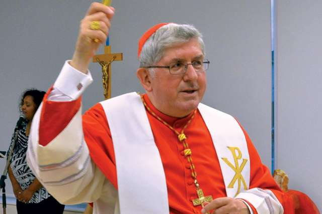 Cardinal Thomas Collins blesses the Cardinal Collins High School Academic Centre.