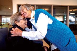 Sr. Marie Donovan is given a welcoming hug by fellow Our Lady's Missionary Sr. Gwen Legault as she settles into a new life in Presentation Manor.
