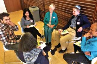 Young people and religious leaders from the Catholic, Muslim and Jewish faiths gather together for the first time at a local interfaith event.