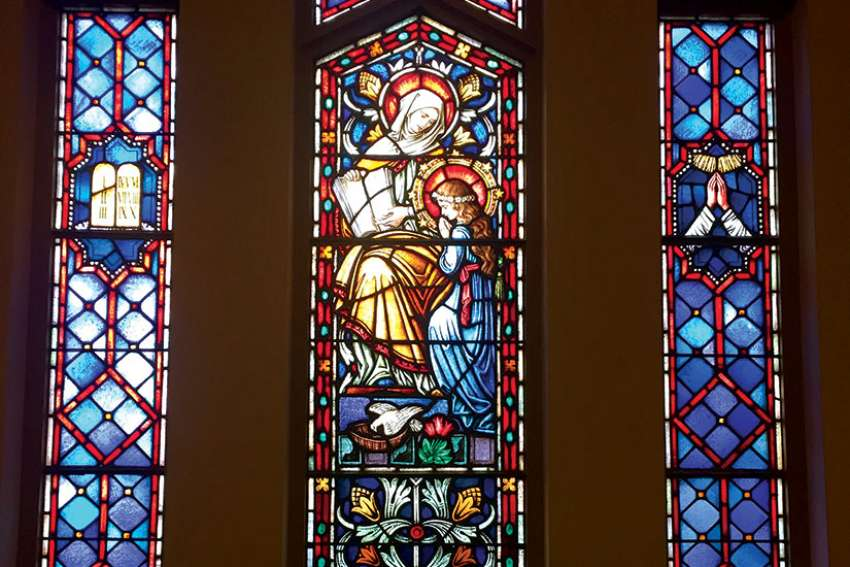 In one of the stained glass windows at Our Lady of Peace Church in Toronto, Mary is being taught about God's Torah by her mother St. Anne.