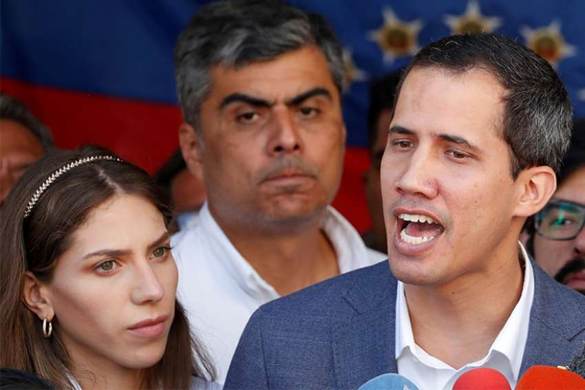 Venezuelan opposition leader Juan Guaido, alongside his wife, Fabiana Rosales, speaks to the media after attending Mass in Caracas Feb. 10, 2019. Although it has publicly taken a neutral stance in the current political crisis in Venezuela, the Vatican has expressed its support for new elections in the country within the year, said a member of a delegation representing Guaido.
