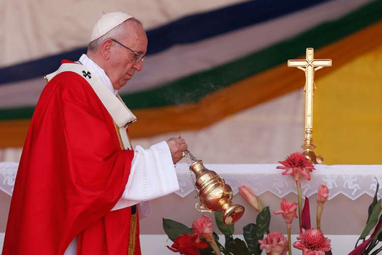 Pope Francis censes the altar as he celebrates Mass in Barthelemy Boganda Stadium in Bangui, Central African Republic, Nov. 30.