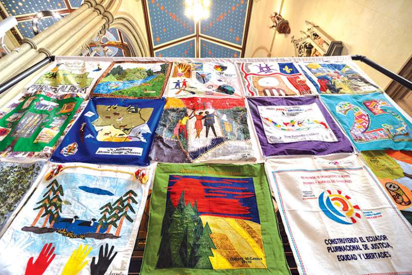 "The Canadian Catholic Organization for Development and Peace's ""Solidarity Quilt"" was on display at the 50th anniversary Mass in Toronto March 4."