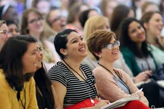 "Young women attend a leadership forum for young Catholic women in 2016 at The Catholic University of America in Washington. In dioceses across the U.S., the 300 attendees are now implementing their ""action plans,"" new initiatives inspired by their gifts, interests and leadership skills."