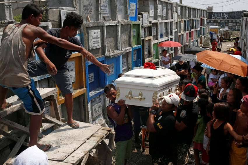Men carry the coffin of Vicente Batiancila Oct. 23, who police say was among five victims of recent drug-related killings, during his funeral in Manila, Philippines. As Filipinos remembered their departed on All Souls' Day, the country's church leaders called on the faithful to also pray for those who fell victim in the government's all-out war against illegal drugs.