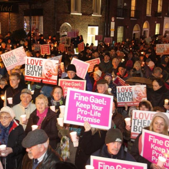 Pro-life demonstrators hold signs during a candlelight vigil outside the Irish parliament in Dublin Dec. 4, calling on the government not to introduce abortion legislation. A crowd estimated at 8,000 people gathered to call on Irish Prime Minister Enda K enny to keep a pledge made in 2011 not to introduce abortion legislation.
