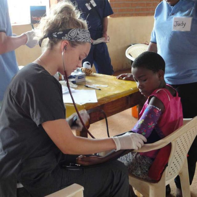 Shayla Roberts looks after a Tanzanian child on the recent Chalice medical mission.
