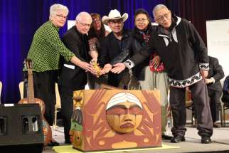 Ottawa Archbishop Terrence Prendergast joins other Truth and Reconciliation Commission members to conclude the end of the report. Archbishop Prendergast acknowledged the harm that the residential schools had on native children.