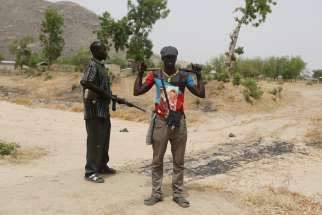 Members of a civilian vigilante group stand guard at the border with Nigeria in Kerawa, Cameroon, March 16, 2016. The latest threat to Christians in Nigeria are the Fulani Herdsmen Terrorists says Aid to the Church in Need's Maria Lozano.