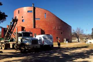 Crews work to repair the damage to St. John The Baptist Church.
