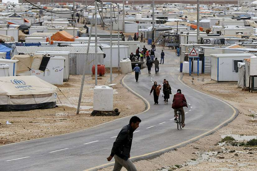 Syrian refugees are seen in Zaatari Camp in Jordan March 29.