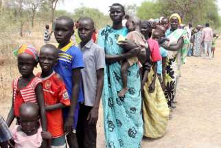 Residents displaced due to the recent fighting between government and rebel forces in Malakal, South Sudan, wait May 2 at a World Food Program outpost in Kuernyang Payam, where thousands have taken shelter.