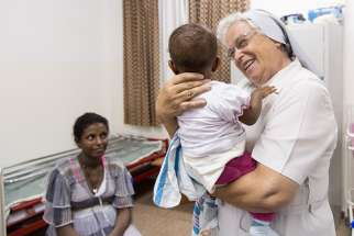 Sr. Laura Girotto takes care of a child in the hospital she was instrumental in building in an area with an illiterate population that was devastated by the mid-1980s famine, and where young mothers — some as young as 12 — were ignorant of basic baby care, which led to far too many deaths.
