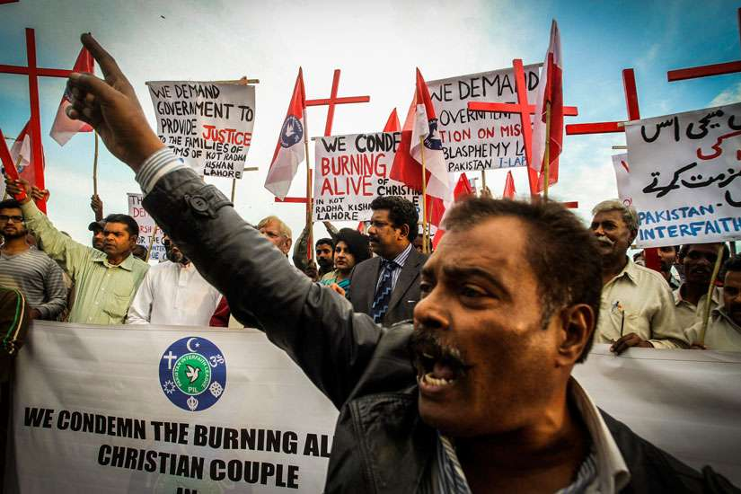 Pakistanis protest Christian couple burned alive for alleged blasphemy in Islamabad, Pakistan Nov. 14, 2014. The U.S. bishops are calling on people of all faiths to pray for those facing religious persecution in the Middle East and elsewhere.