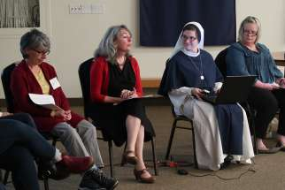 Psychotherapist Mary Marrocco, second from left, speaks with clergy and counsellors at a Nov. 15 seminar on post-abortive pastoral care hosted by the Sisters of Life in Toronto.