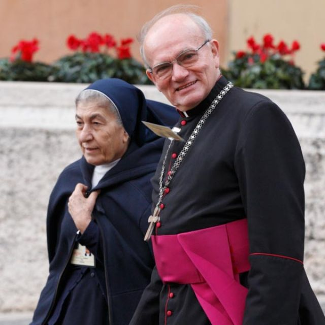 Msgr. Philippe Brizard, former director of the aid agency L'Oeuvre d'Orient, and Sister Clauda Achaya Naddaf from Syria arrive for the Synod of Bishops for the Middle East at the Vatican Oct. 19. Both are observers at the synod. Sister Naddaf, superior o f the Sisters of Our Lady of Charity of the Good Shepherd, said she was surprised the synod's working document and the vast majority of synod speeches did not mention problems concerning women in the Middle East.