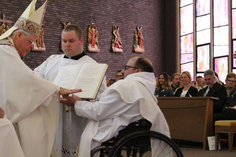 Wheelchair-bound Fr. Trevor Plug is ordained to the priesthood May 21 by St. Catharines Bishop Gerard Bergie.
