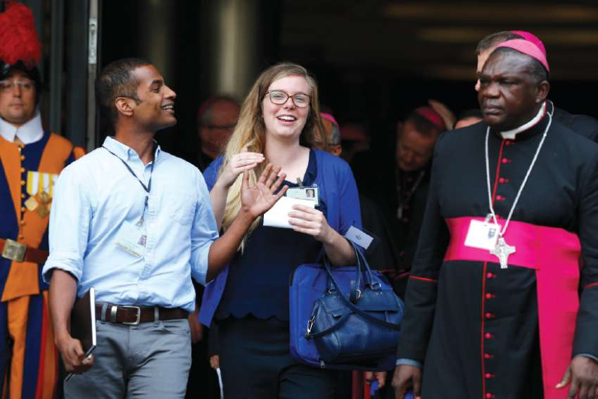 Canadian synod collaborators Prevain Devendran, left, and Allyson Kenny leave a session of the synod Oct 5.