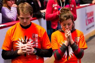 Volunteers pray during pro-life youth rally. On Aug. 1, LifeCanada will hold it's National Day for Prayer and Fasting for abortion issues.