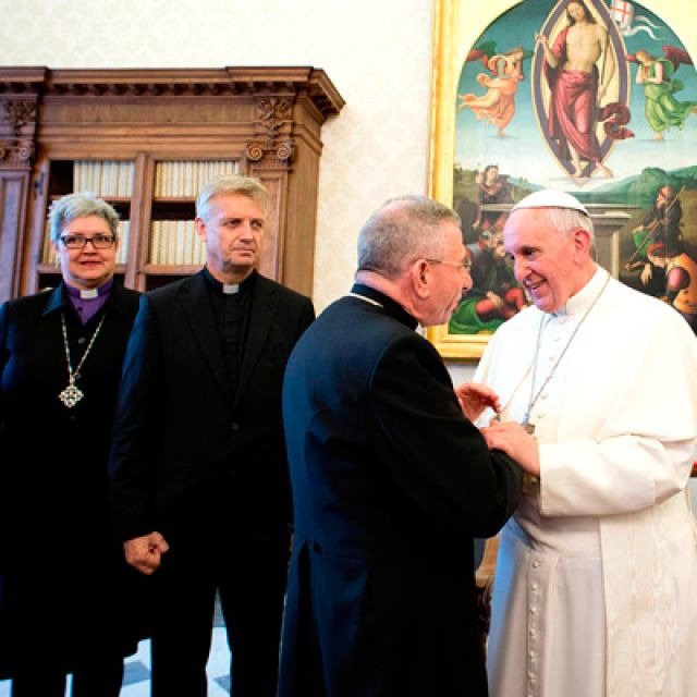 Pope Francis is greeted during a meeting with members of the Lutheran World Federation at the Vatican Oct. 21.