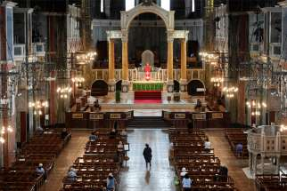 People are pictured in mid-June praying at London's Westminster Cathedral. In a private ceremony, British Prime Minister Boris Johnson and his fiancee, Carrie Symonds, had their 4-month-old son baptized Sept. 12 in the cathedral's Lady Chapel.