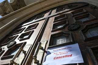 The pandemic has resulted in unfamiliar signs posted on church doors.