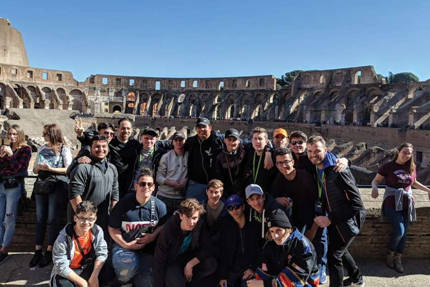 Students from Chaminade College School pose inside of the Colosseum in Rome. Seventeen students spent their March break visting churches and historical sites across Europe.