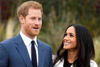 Britain's Prince Harry poses with Meghan Markle Nov. 27 in the Sunken Garden of Kensington Palace in London after announcing their engagement. Markle attended Immaculate Heart High School in Los Angeles.