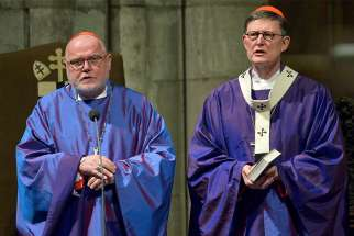Cardinal Reinhard Marx of Munich-Freising, president of the German bishops' conference, and Cardinal Rainer Woelki of Cologne concelebrate Mass March 6 during the opening of the annual meeting of Germany's bishops at the cathedral in Cologne