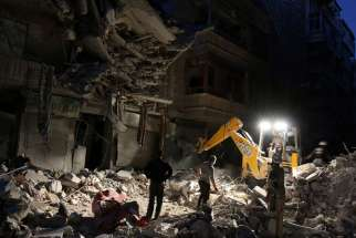 Civil Defence members search for survivors Sept. 27 at a site hit by an airstrike in the rebel-held al-Shaar neighborhood of Aleppo, Syria. Pope Francis said Sept. 29 that logic of weapons and hidden interests continues to devastate Middle Eastern countries in conflict.