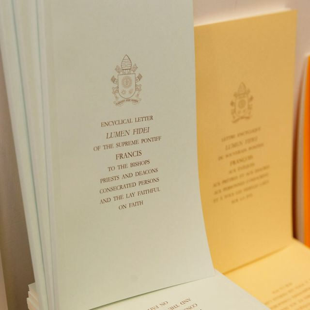 "Copies of Pope Francis' first encyclical, ""Lumen Fidei"" (""The Light of Faith""), are seen at the the Vatican press office July 5."