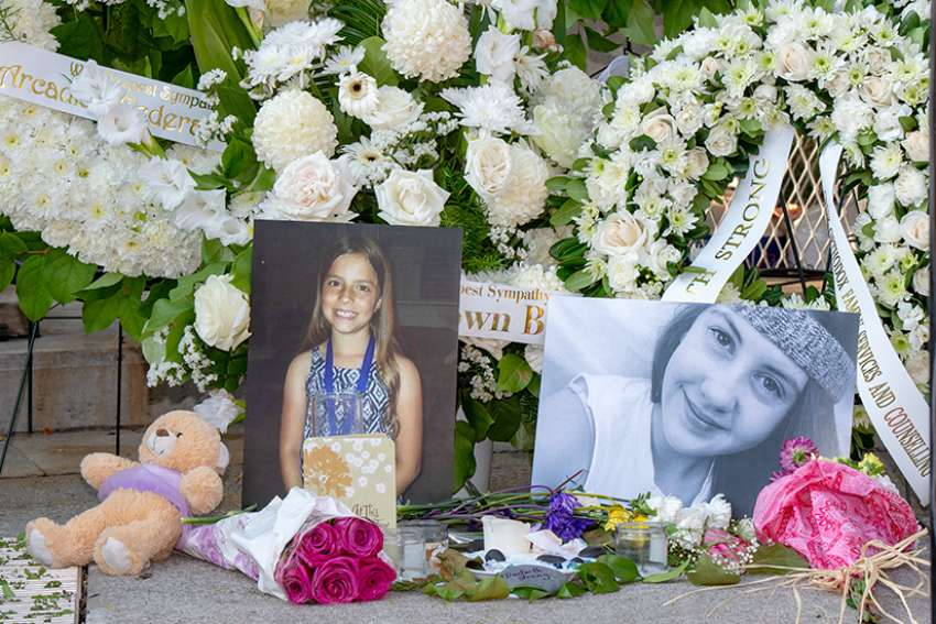 Danforth shooting victims, Reese Fallon, 18, and Julianna Kozis, 10, are honoured with flowers and candlelight at a Danforth Av. vigil July 25.