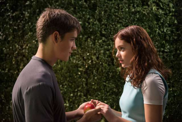 "Brenton Thwaites and Odeya Rush star in a scene from the movie ""The Giver."" Catholic News Service classification, A-II -- adults and adolescents. Motion Picture Association of America rating, PG-13 -- parents strongly cautioned. Some material may be inap propriate for children under 13."