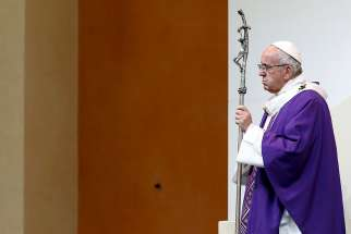 Pope Francis holds his crosier as he celebrates Mass in Carpi, Italy, April 2.