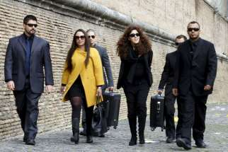 "Italian laywoman Francesca Chaouqui, second from right, and her lawyer Laura Sgro, second from left, arrive for the so-called ""Vatileaks"" trial at the Vatican March 14. Chaouqui is one of five people on trial for leaking confidential Vatican documents that were published in two books."