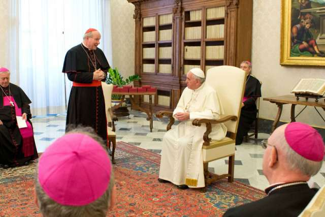 Austrian Cardinal Christoph Schonborn of Vienna talks with Pope Francis during a meeting with Austrian bishops at the Vatican Jan. 30.