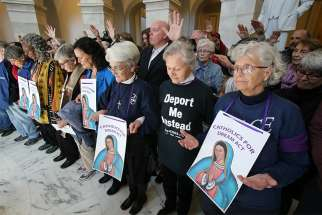 "Sisters of Mercy and others pray inside the Russell Senate Office Building in Washington Feb. 27 during a ""Catholic Day of Action for Dreamers"" protest to press Congress to protect ""Dreamers."""