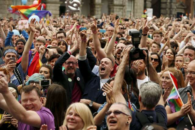 People in Dublin react as Ireland voted in favour of allowing same-sex marriage May 23.