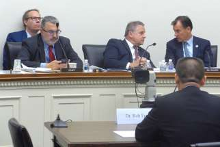 Bob Fu, founder of ChinaAid, addresses Rep. Chris Smith, R-N.J., chairman of the House Foreign Affairs' Subcommittee on Africa, Global Health, Global Human Rights and International Organizations, and other members of the subcommittee Sept. 27. HU's comments concerned the Chinese government's persecution of Christians and adherents of other faiths.