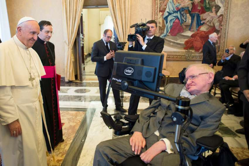 Pope Francis greets Stephen Hawking, a theoretical physicist and cosmologist, during a Nov. 28 meeting with the Pontifical Academy of Sciences at the Vatican.