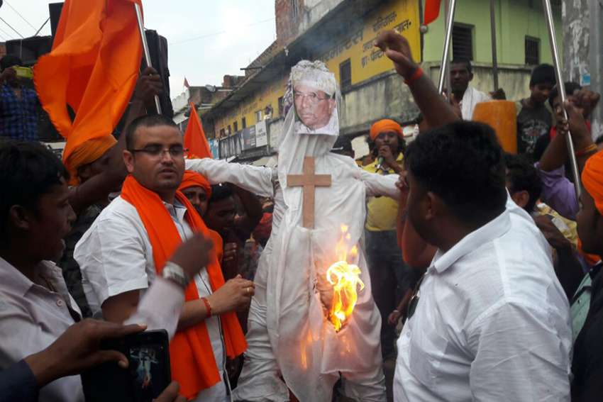 Hindu nationalists are pictured in a recent photo burning an effigy of Cardinal Telesphore Toppo, archbishop of Ranchi, India, Sept. 2017.