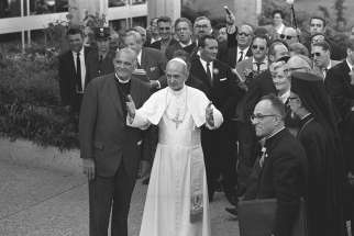 Pope Paul VI stands next to Eugene C. Blake, general secretary of the World Council of Churches, as he arrives at the headquarters of the WCC in Geneva June 10, 1969. Pope Francis is scheduled to attend an ecumenical prayer service and meeting at the WCC during a one-day visit to Geneva June 21.