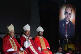Cardinal Oscar Rodriguez Maradiaga of Tegucigalpa, Honduras, centre, speaks May 22 during vigil held on the eve of the beatification of Archbishop Oscar Romero in San Salvador.