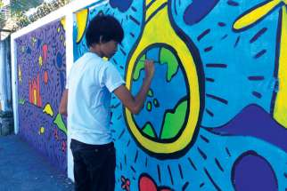 Br. Jaazeal Jakosalem works in youth ministry in Cebu City and Negros Island in the Philippines, educating Filipino youth about Church teaching on the environment. Youth in Jakosalem's program paint murals to spread the word about climate change and environmental degradation.