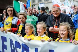 "Cardinal Raymond L. Burke walks in the ninth national March for Life in Rome May 18, 2019. He resigned from the Dignitatis Humanae Institute June 25, saying it had become ""more and more identified with the political program"" of Steve Bannon."