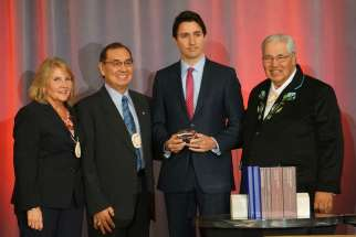 Truth and Reconciliation Commission commissioners Marie Wilson and Chief Wilton Littlechild, Prime Minister Justin Trudeau and TRC chair Justice Murray Sinclair Dec. 15 at the closing ceremony of the TRC.