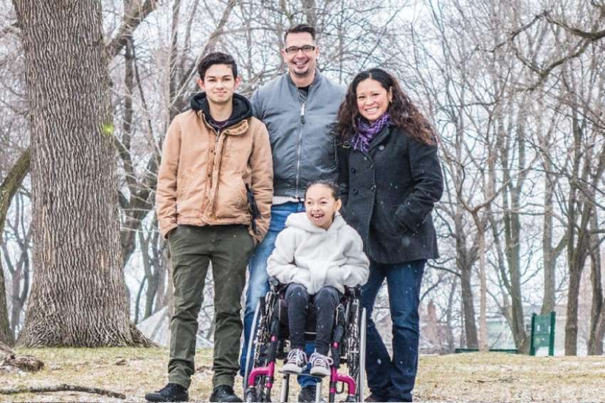 Athena Santos Roy hopes to finally walk after surgery in St. Louis next month. Athena is pictured with her brother Phoenix Santos Roy, stepfather James Duncanson and mother Fiona Santos.